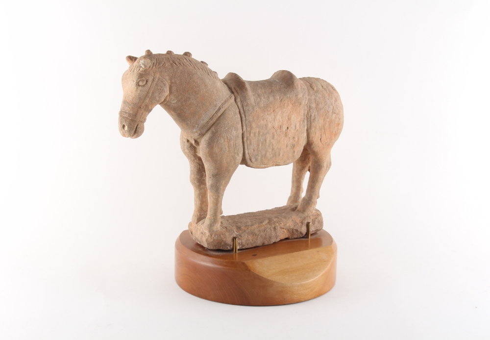 Property of a gentleman - a Chinese Tang style pottery model of a horse, on wooden stand, 13.