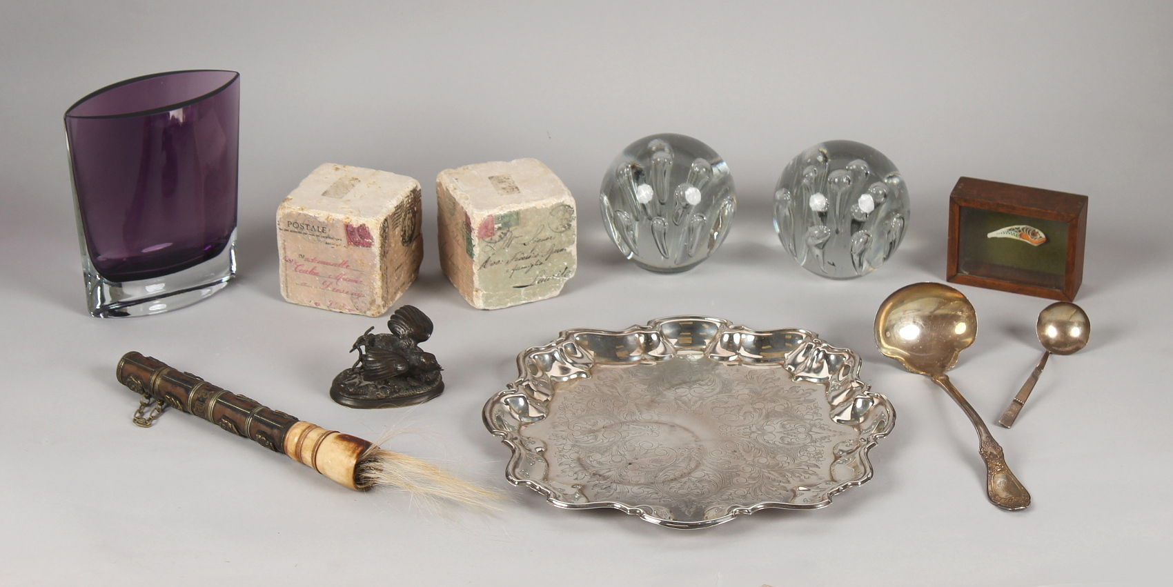 Property of a lady - a group of decorative items including two glass dump weights with bubble