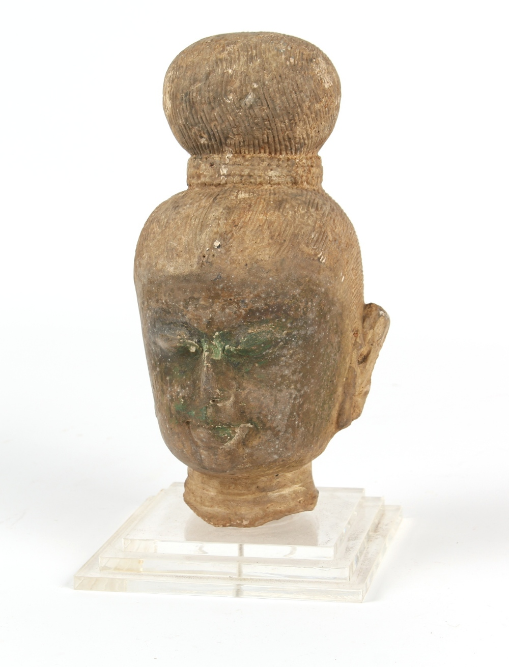 Property of a gentleman - an antique carved stone Buddha head, South East Asia, mounted on a perspex