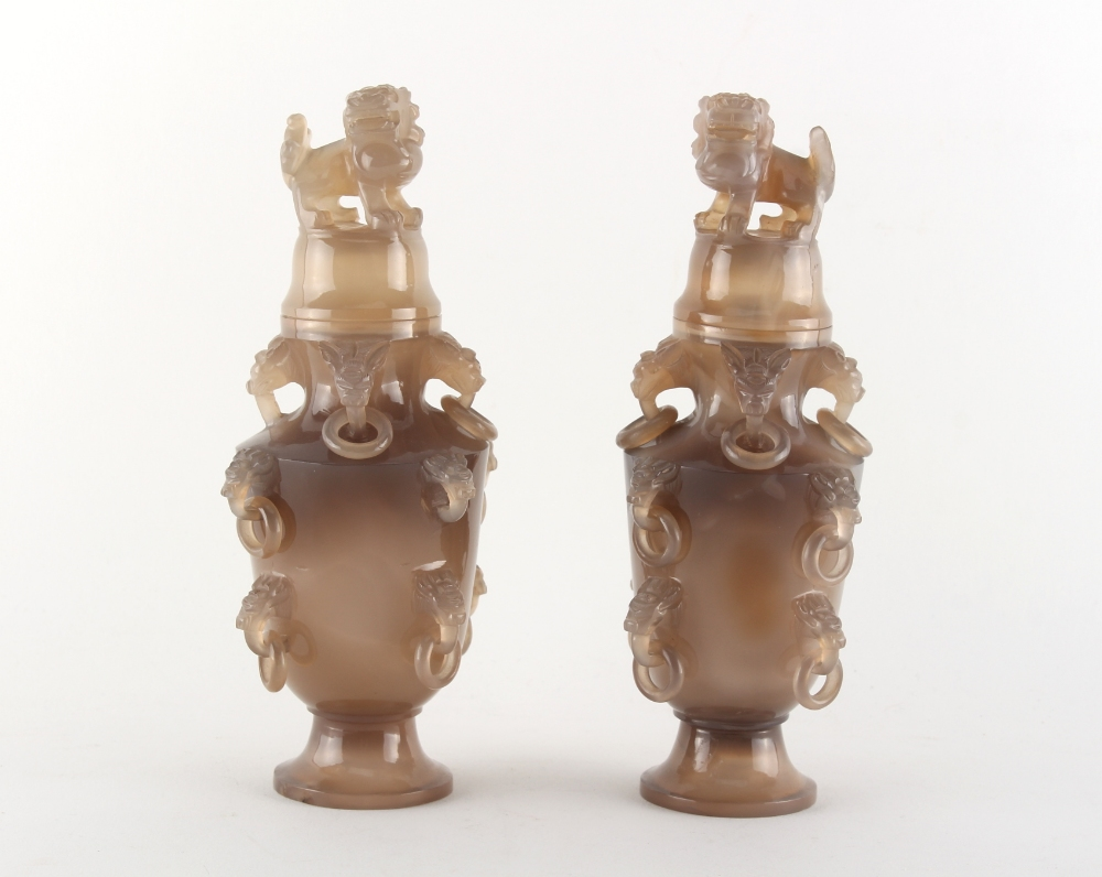 A pair of Chinese carved grey agate vases & covers, with temple lion finials & ring handles, each