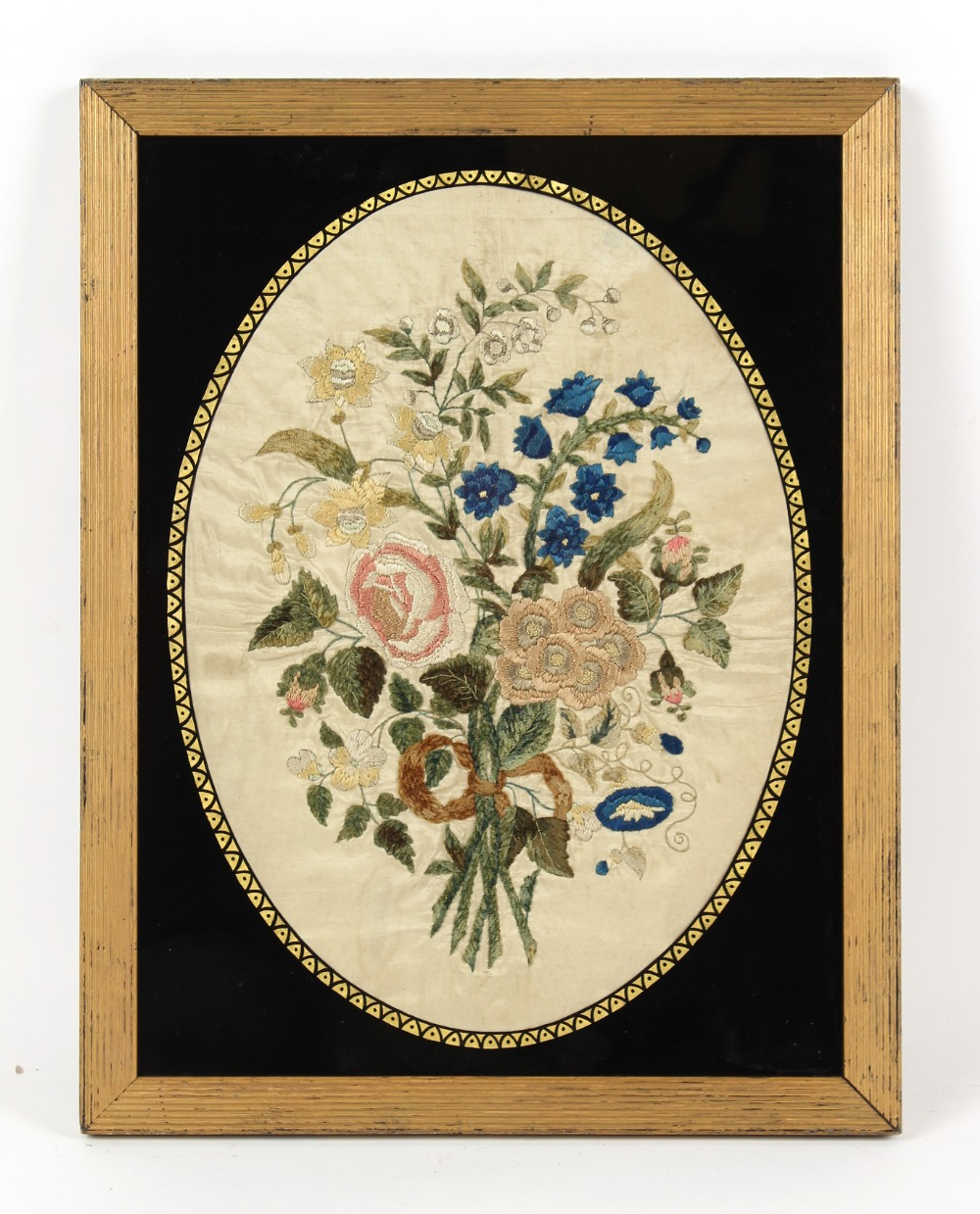 Property of a gentleman - a 19th century silkwork oval picture depicting a bouquet of flowers, in