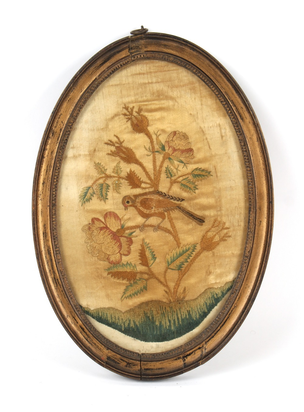 Property of a gentleman - a 19th century silkwork oval picture depicting a bird & flower, in
