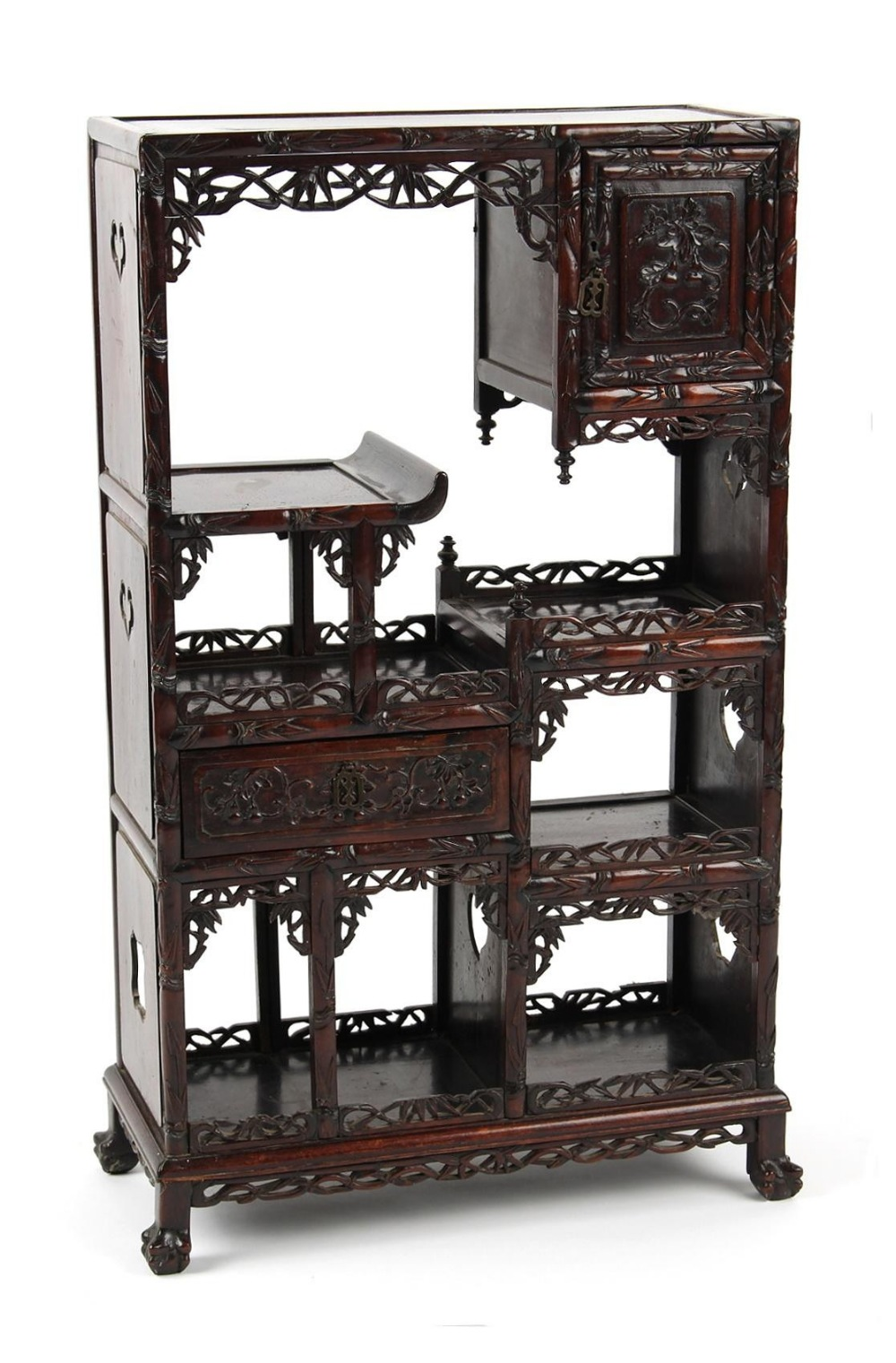 A late 19th century Chinese carved hongmu display cabinet of small size, fitted with a door, a