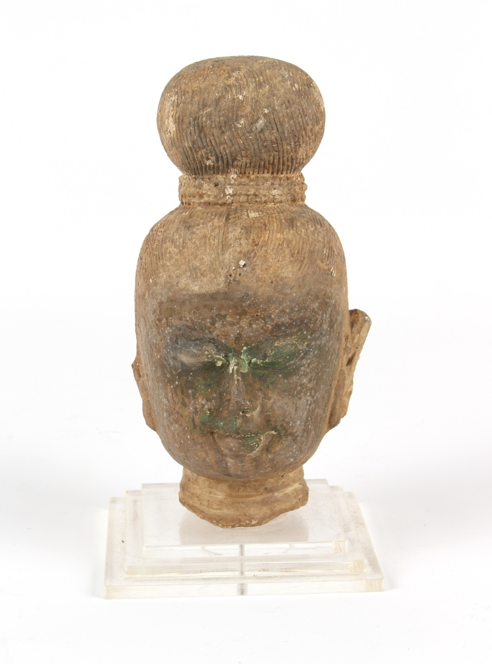 Property of a gentleman - an antique carved stone Buddha head, South East Asia, mounted on a perspex - Image 2 of 2