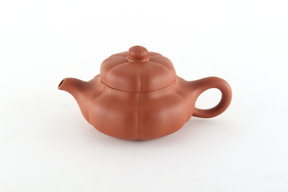 A Chinese Yixing teapot, of melon form, seal marks to base and another to inside of cover, 5.