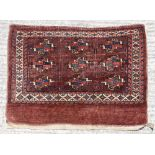 Property of a gentleman - an antique Turkoman juval, with brown-red ground, 31 by 44ins. (79 by