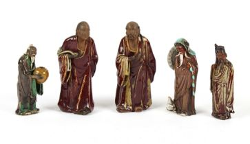Property of a gentleman - three Chinese Shiwan figures, the tallest 12ins. (30.5cms.) high; togethe