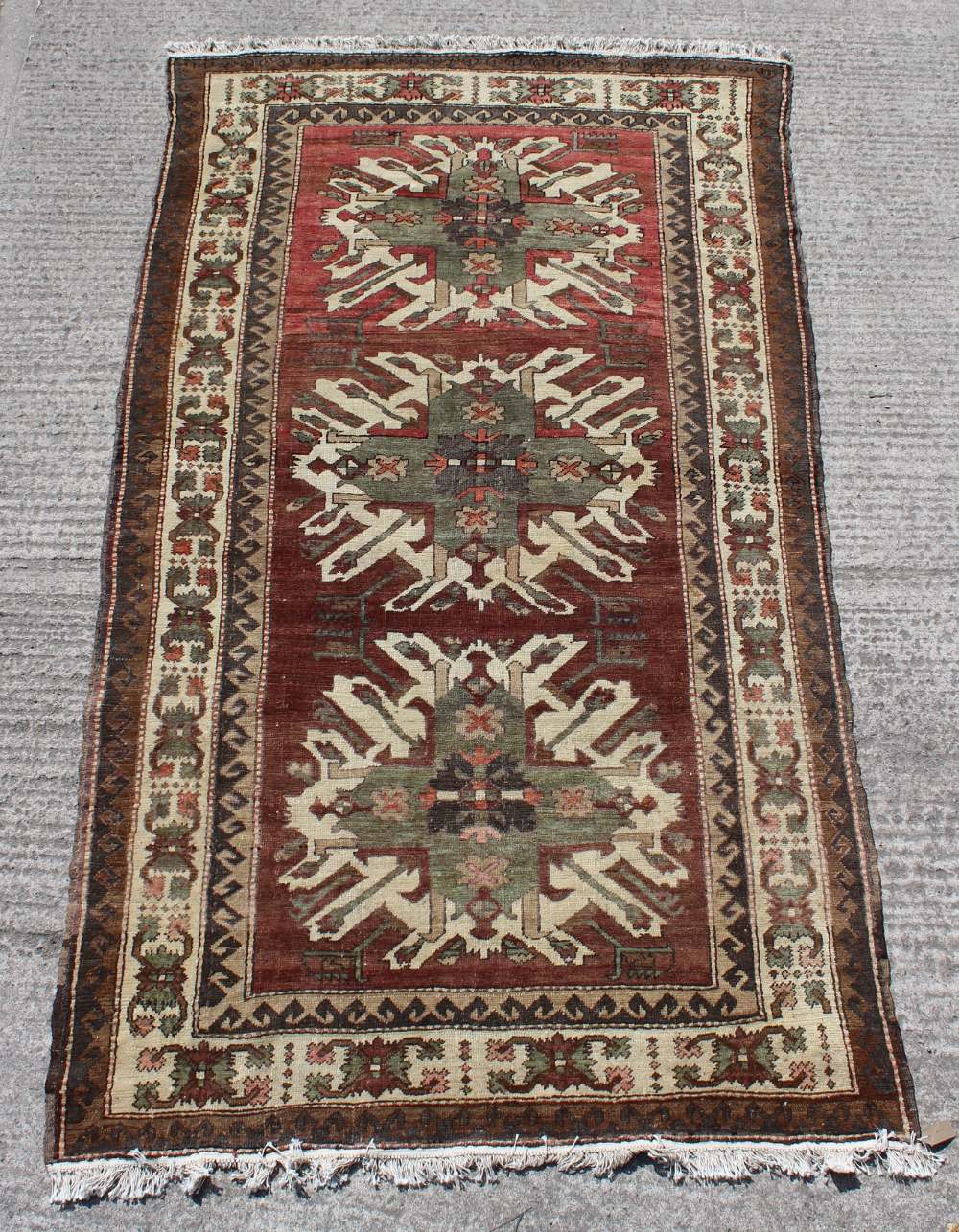 Property of a gentleman - a Caucasian Kazak large rug, with brown-red ground, 121 by 67ins. (307