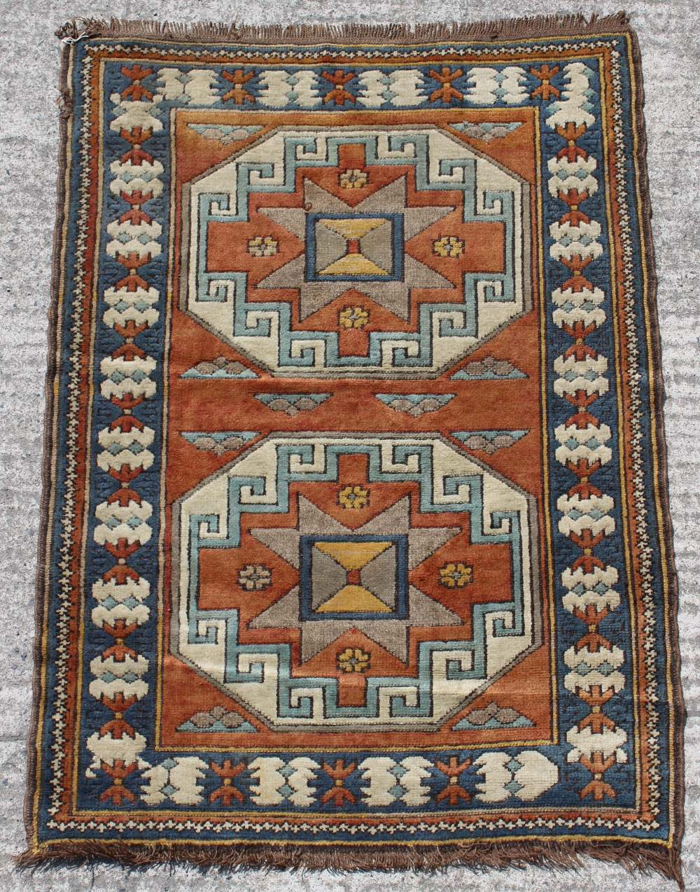 Property of a gentleman - a Turkish hand knotted rug of Kazak design, 58 by 43ins. (148 by 99cms.).