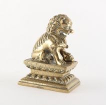 A Chinese polished bronze Buddhistic lion, 19th century, 4.15ins. (10.5cms.) high.