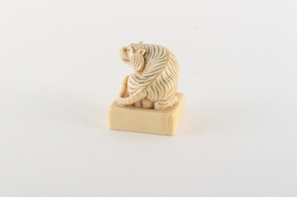 Property of a gentleman - a Chinese carved ivory square seal modelled as a seated tiger, early - Image 2 of 3