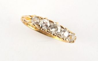 A late 19th / early 20th century 18ct yellow gold diamond five stone ring, with carved setting,