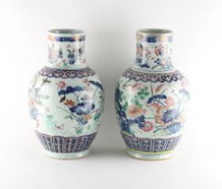 Two very similar late 19th century Chinese famille rose vases, painted with birds among flowering