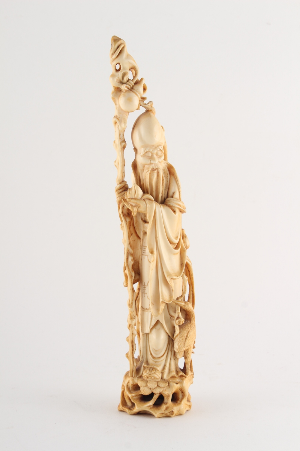 Property of a lady - a 19th century Chinese carved ivory figure of Shoulao, modelled standing