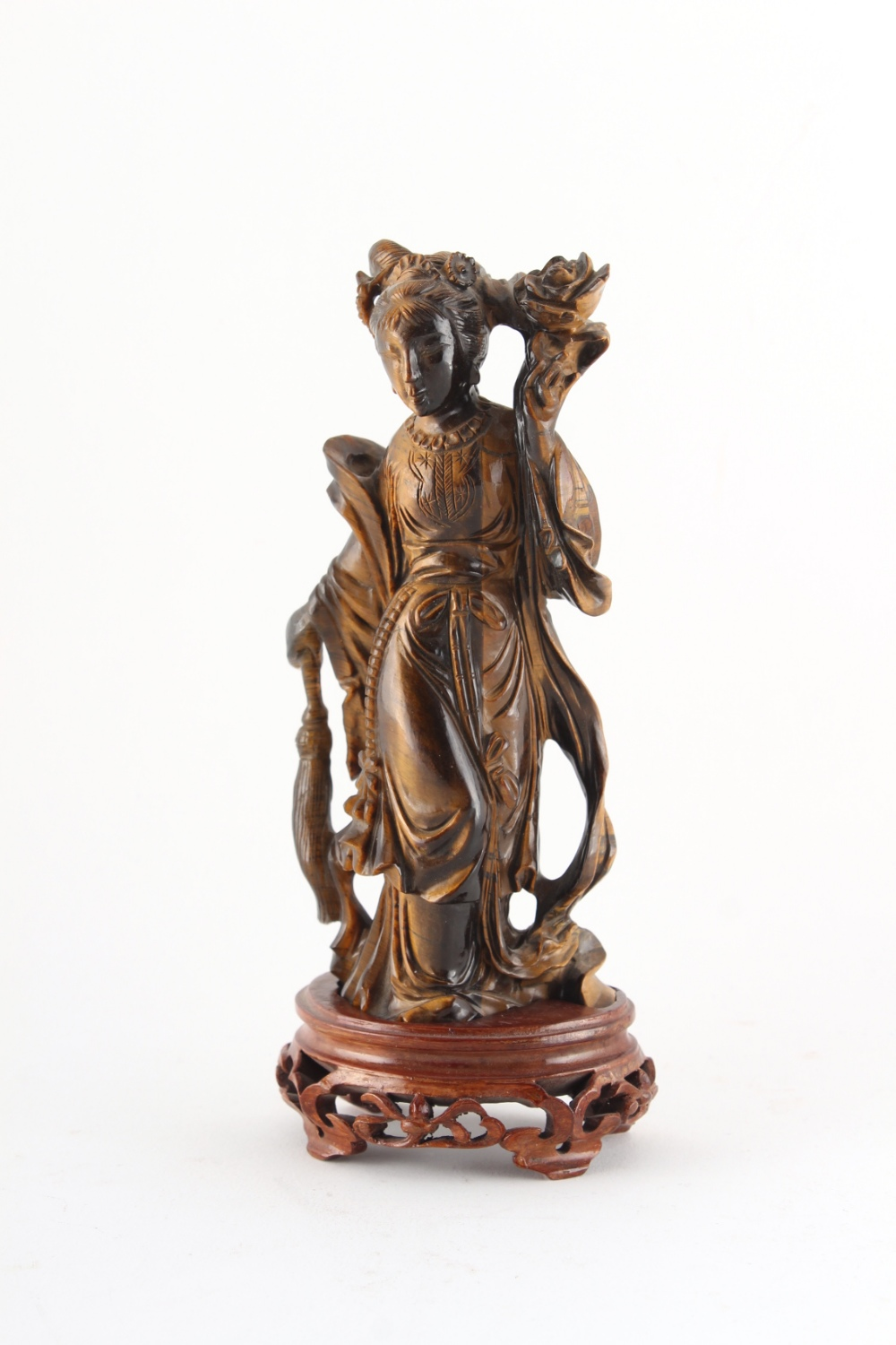Property of a deceased estate - a Chinese carved tiger's eye figure of Guanyin, on fitted wooden