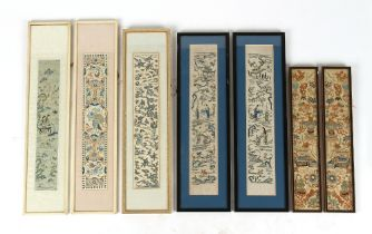 A group of seven early 20th century Chinese embroidered silk panels comprising two pairs & a single,