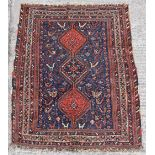 Property of a lady - a Persian Afshar rug, first half 20th century, 62 by 51ins. (157 by 130cms.).