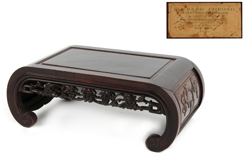Property of a gentleman - an early 20th century Chinese carved blackwood kang table, the underside