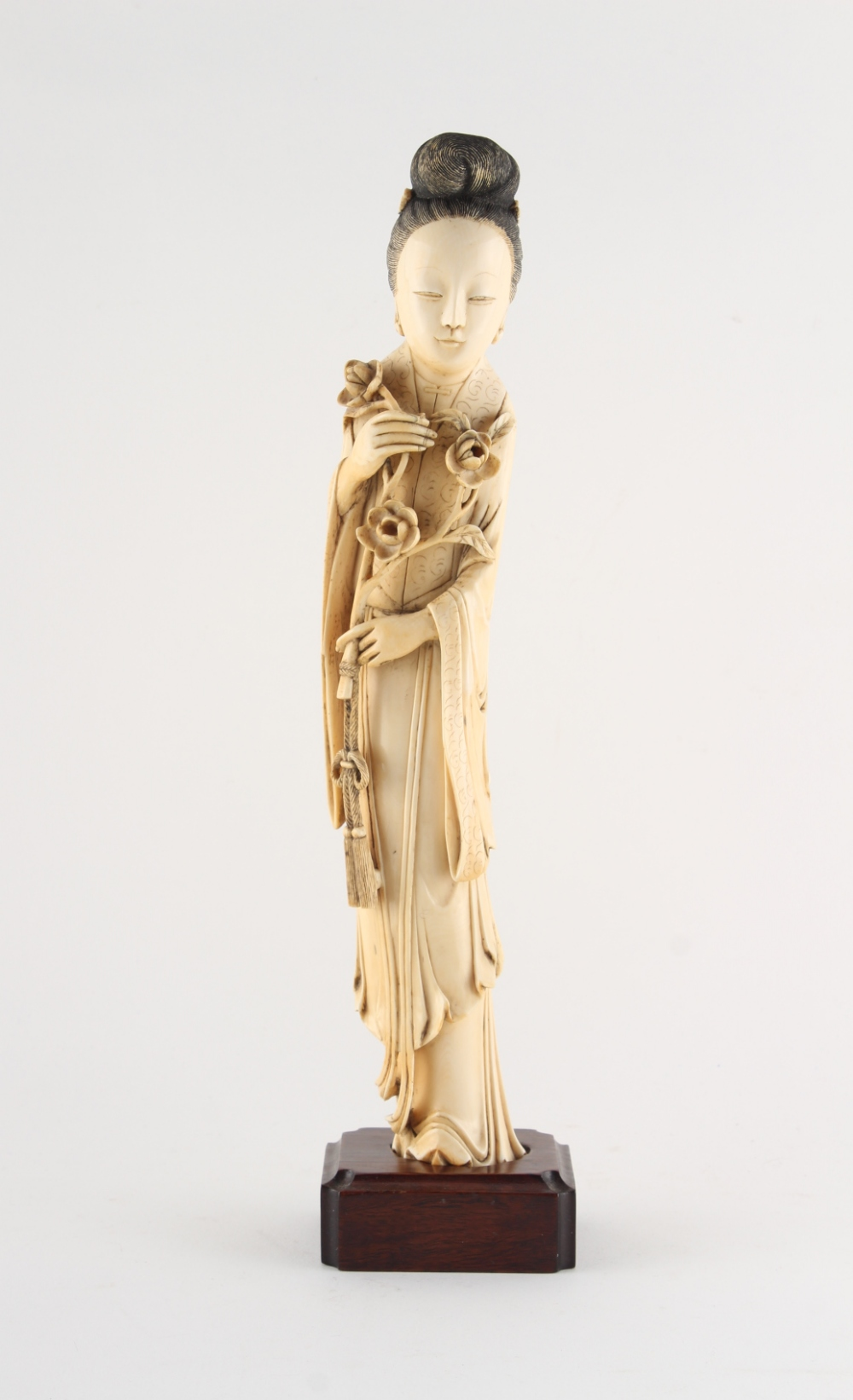 Property of a gentleman - a Chinese carved ivory figure of a lady in flowing robes, 19th century,