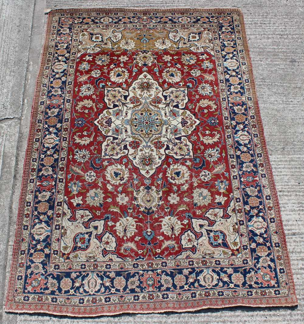 Property of a gentleman - a Persian Tabriz small carpet with red ground, pronounced abrash to one