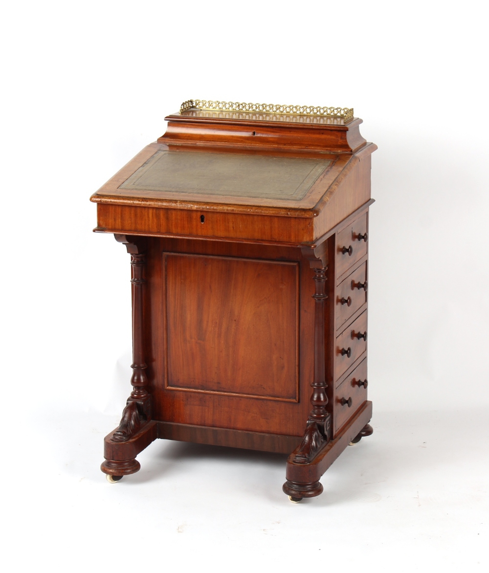 Property of a deceased estate - a Victorian mahogany davenport, 21.1ins. (53.5cms.) wide (overall).