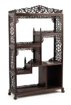 A Chinese carved hongmu display cabinet, of small size, late 19th / early 20th century, 51.75ins. (