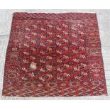 Property of a gentleman - a Turkoman carpet, damages, 87ins. (227cms.) square.