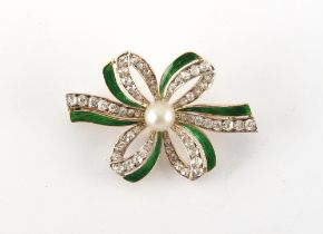 An early 20th century unmarked yellow gold pearl diamond & green enamel ribbon brooch, the old eight