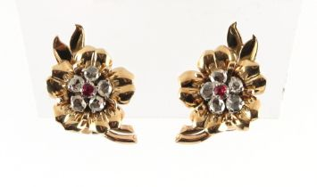 A pair of unmarked yellow gold ruby & diamond earrings, of floral form, each set with five rose