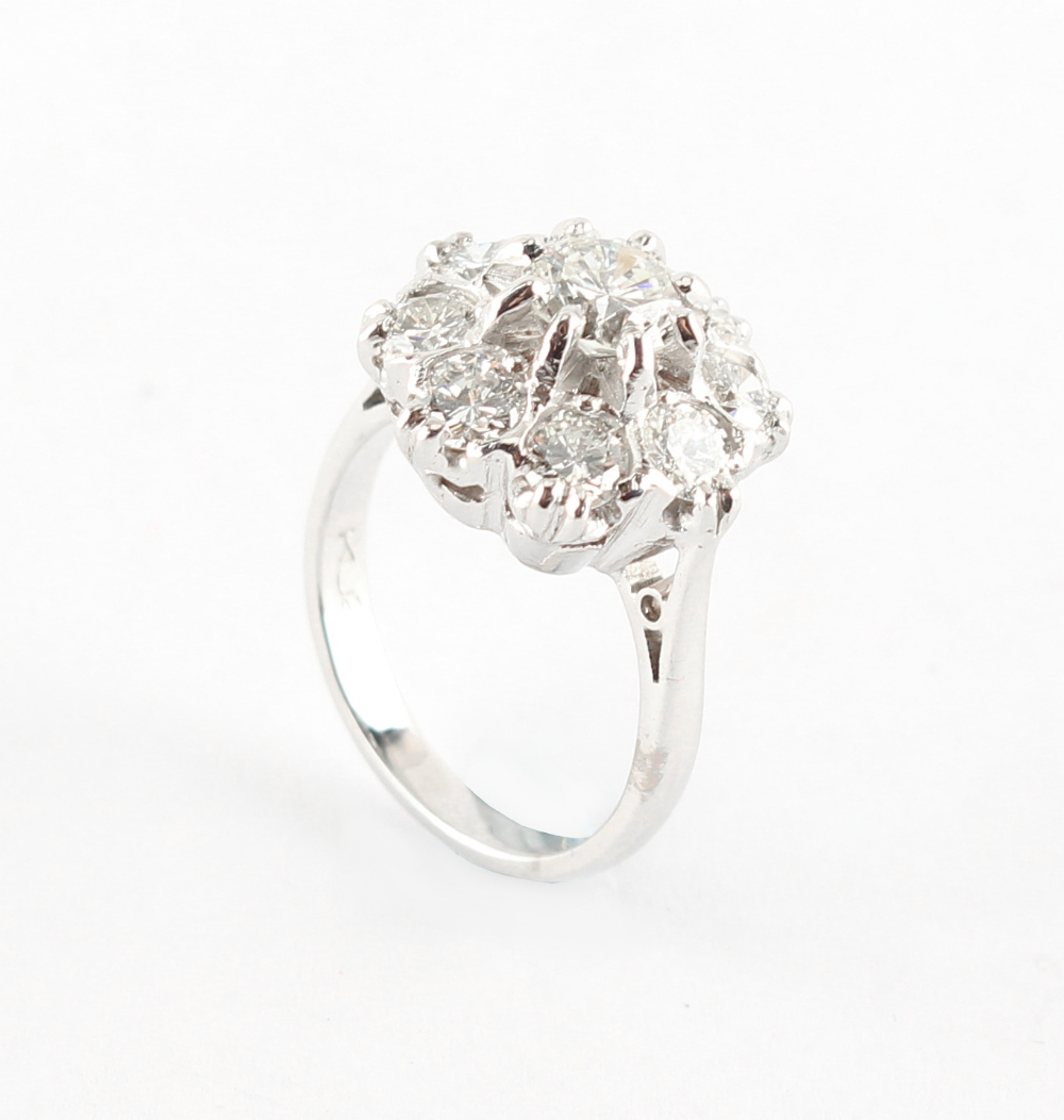 An 18ct white gold diamond cluster ring, with nine round brilliant cut diamonds, the estimated total