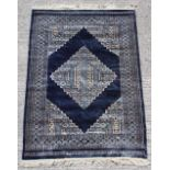 Property of a gentleman - a good quality hand knotted part silk rug, Pakistan, with navy ground,
