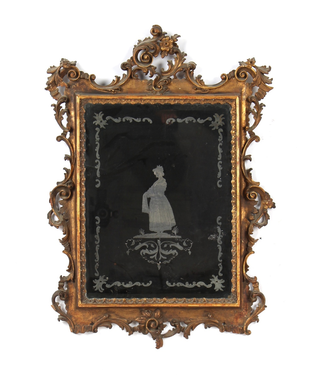 Property of a deceased estate - a 19th century carved giltwood framed wall mirror with engraved