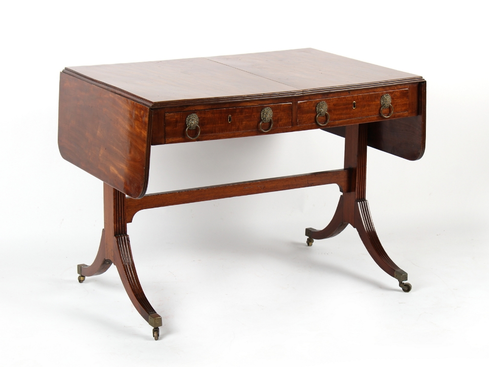 Property of a gentleman - an early 19th century Regency period mahogany sofa table with brass lion