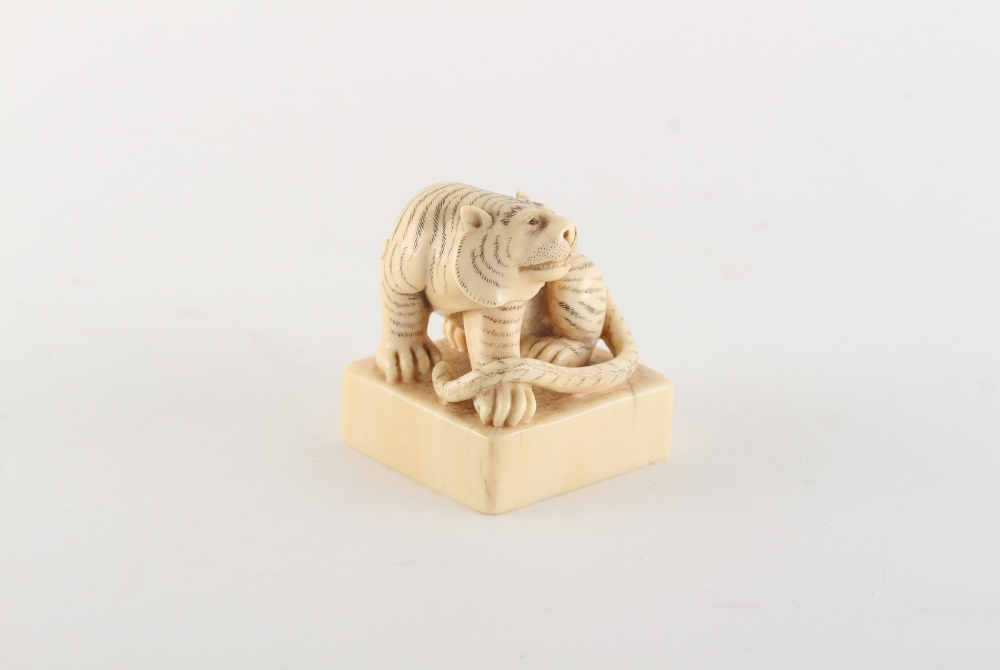 Property of a gentleman - a Chinese carved ivory square seal modelled as a seated tiger, early
