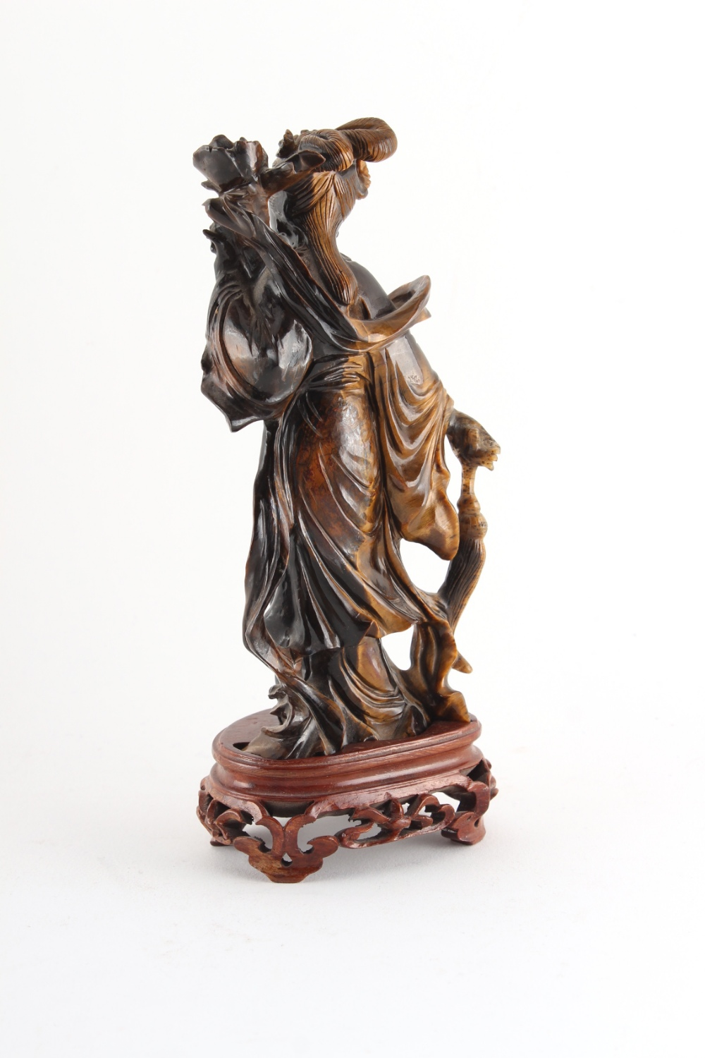 Property of a deceased estate - a Chinese carved tiger's eye figure of Guanyin, on fitted wooden - Image 2 of 2