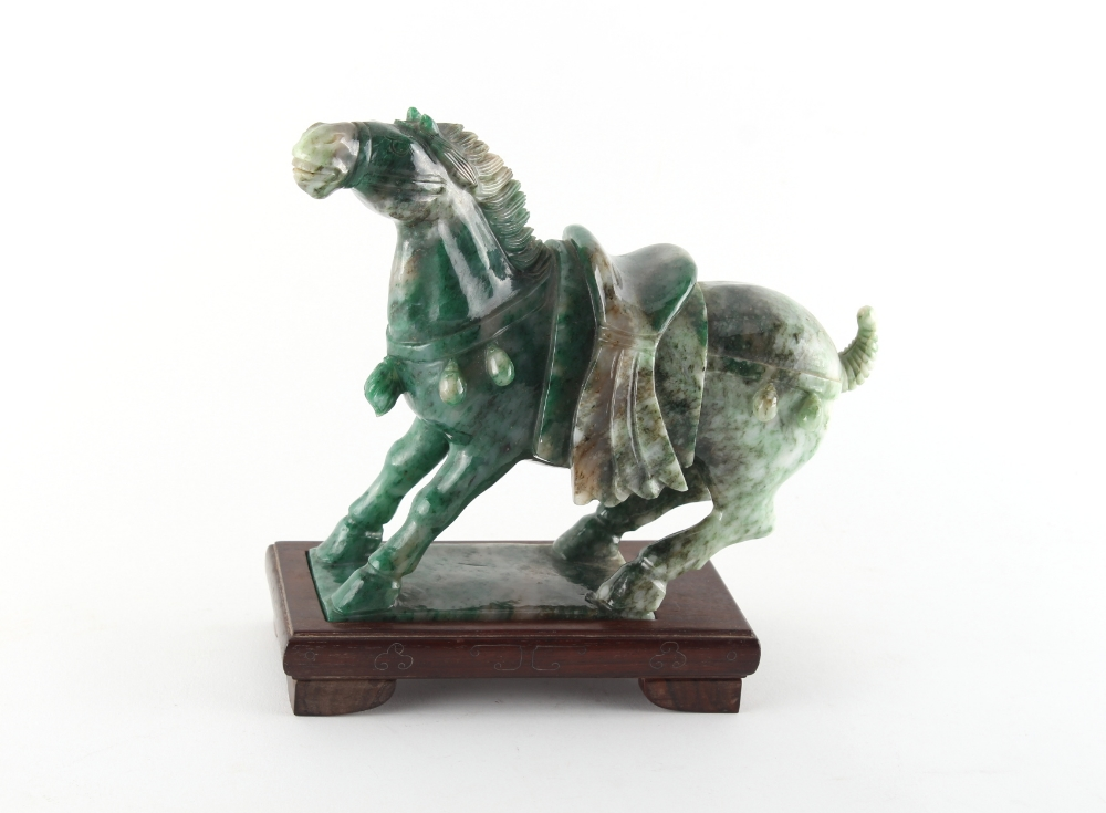 Property of a gentleman - a Chinese Tang style carved nephrite jade model of a caparisoned horse,