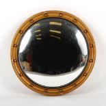 Property of a gentleman - a gilt circular framed convex mirror, first half 20th century, 21.5ins. (