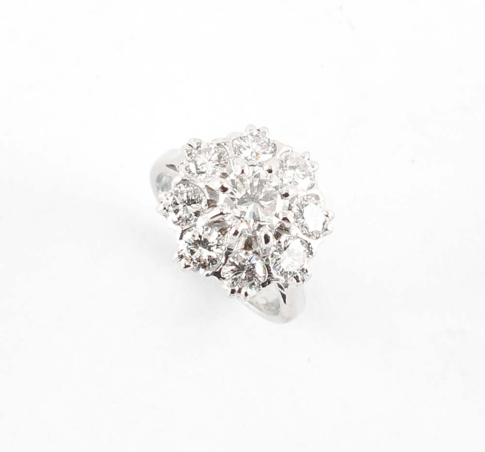 An 18ct white gold diamond cluster ring, with nine round brilliant cut diamonds, the estimated total - Image 2 of 2
