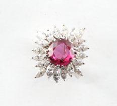 A very good platinum ruby & diamond cluster ring, the unheated cushion cut Thai ruby weighing 2.93
