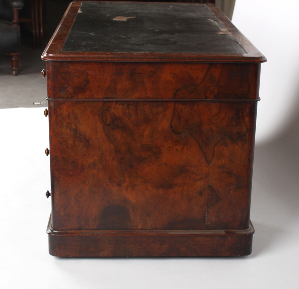 A Victorian figured walnut twin pedestal desk with nine mahogany lined drawers, 54.25ins. ( - Image 2 of 3