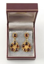 A pair of 18ct yellow gold cabochon garnet earrings, with post & butterfly fastenings, maker's