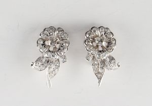 A pair of white gold diamond floral earrings, with clip fastenings, the estimated total diamond