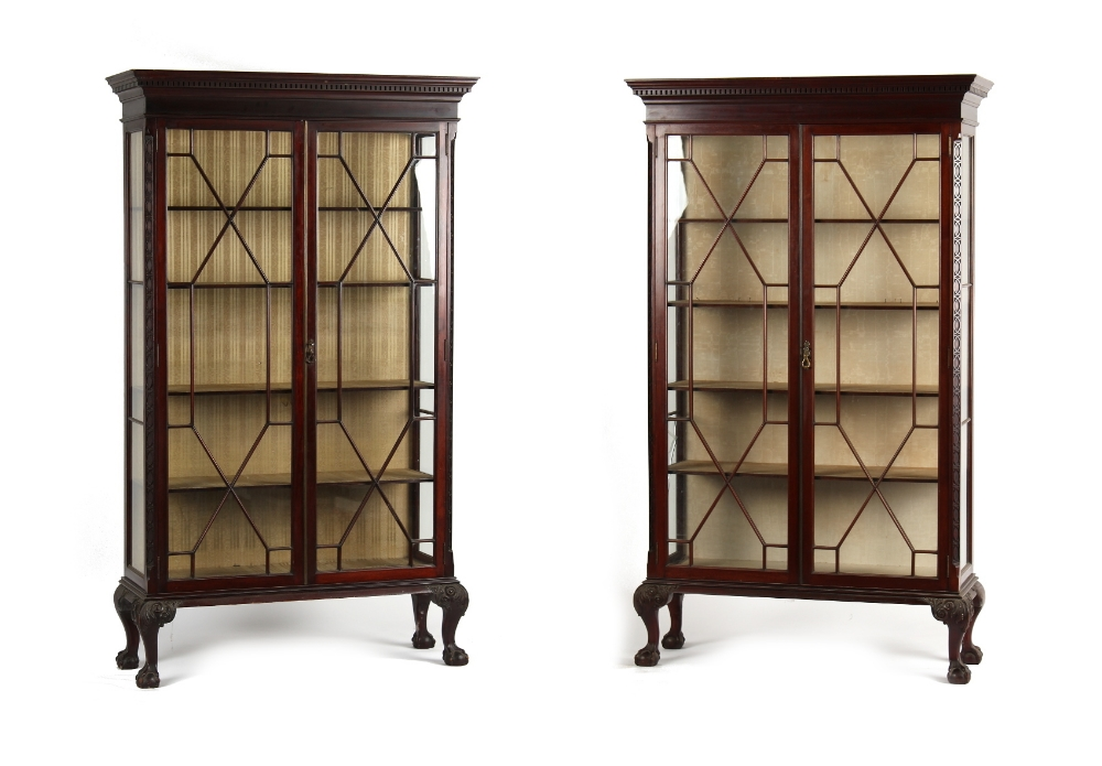 A pair of Edwardian Chippendale style mahogany china display cabinets, each with a dentil cornice