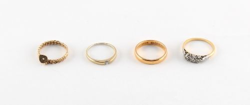 A 22ct gold wedding band, size L, approximately 4.4 grams; together with an unmarked gold ring set