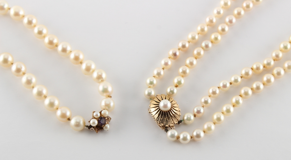 A cultured pearl two row necklace, the uniform pearls approximately 7mm diameter; together with a - Image 2 of 2