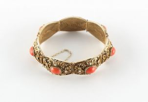 A Chinese silver gilt filigree & coral panel bracelet, approximately 45.6 grams.