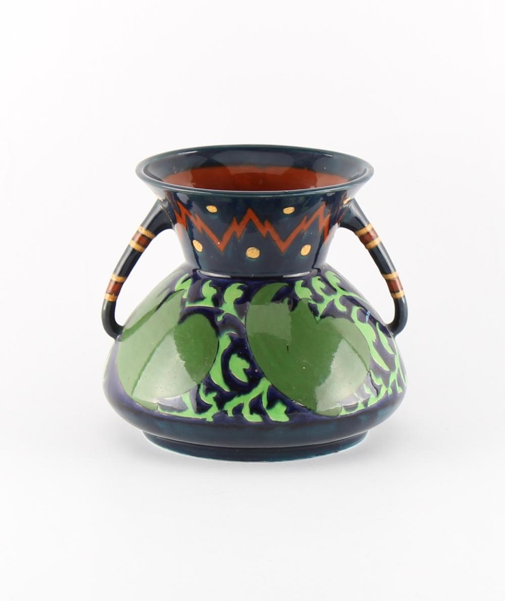 A Wileman & Co. Foley Intarsio vase designed by Frederick Rhead, pattern no. 3004, 4.75ins. (12cms.)