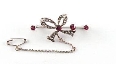 An Edwardian ruby & diamond ribbon brooch, 41mm long, boxed.