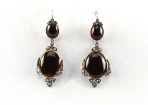 A pair of 19th century cabochon garnet & rose cut diamond pendant earrings, for pierced ears, with