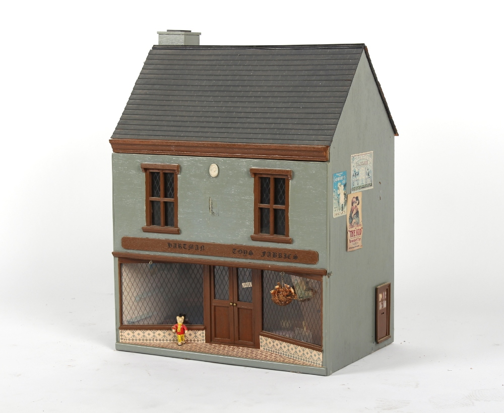 A doll's house entitled 'Hartman Toys Fabric', with furniture & furnishings, 19ins. (48cms.) long.